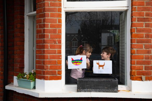 Artwork depicting animals, created by (left to right) Romey and Iggy is displayed in the windows of a row of houses in Acton, London. Photo David Parry/PA Wire