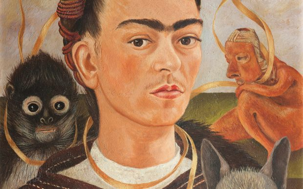 Frida Kahlo, Self-Portrait with Small Monkey. Credit: Frida Kahlo, Self-Portrait with Small Monkey, 1945, oil on masonite, Collection Museo Dolores Olmedo, Xochimilco, Mexico © 2020 Banco de México Diego Rivera Frida Kahlo Museums Trust, Mexico, D.F. / Artists Rights Society (ARS), New York