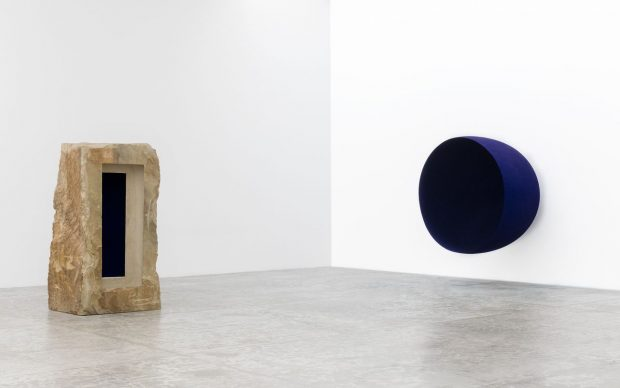 Left: Untitled, 1992. Sandstone and pigment, 230 x 122 x 103 cm. Right: Void, 1989. Fibreglass and pigment, 200 x 200 x 152.5 cm. Photograph: Michel Zabe © Anish Kapoor. All rights reserved DACS, 2021