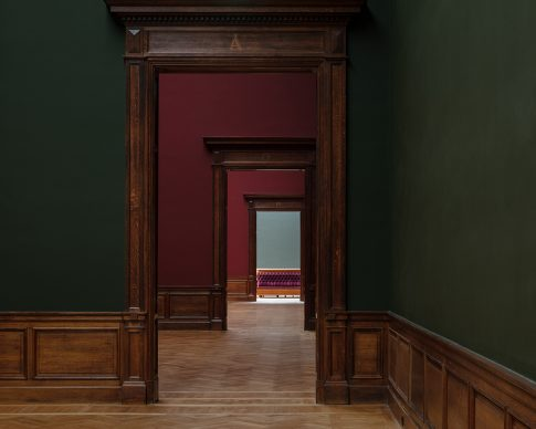 """Royal Museum of Fine Arts, Anversa by KAAN Architecten. 19th-century museum - """"While visiting the historical museum, guests walk through an enfilade of exhibition rooms tinted in dark pink, green and red"""" © Stijn Bollaert"""